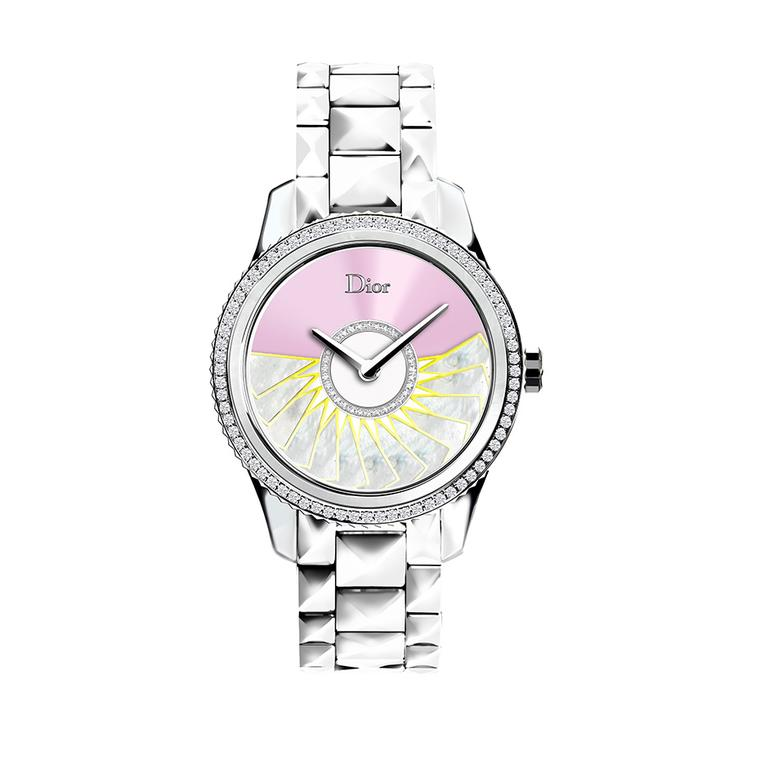 The oscillating weight on the pink Dior VIII Grand Bal Plissé Soleil watch is decorated with white mother-of-pearl marquetry, finished with yellow hems and set with diamonds