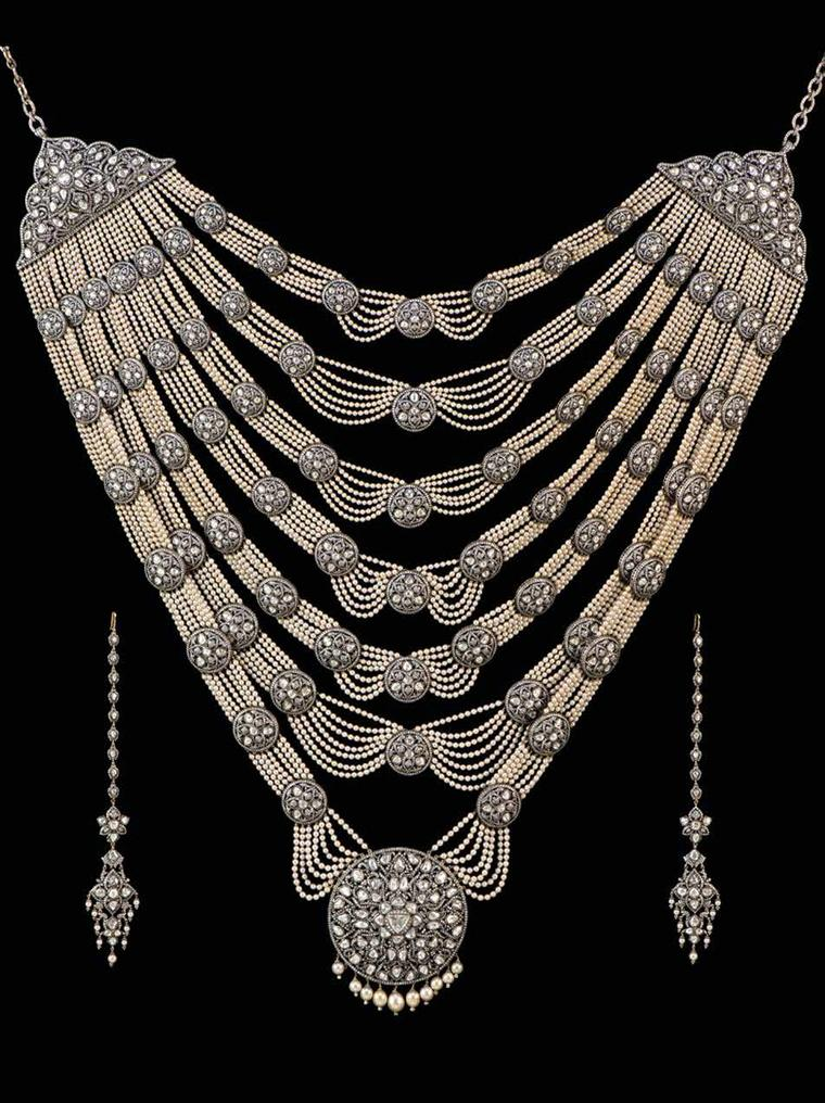 Necklace and earrings from a Munnu Kasliwal wedding suite in gold, featuring silver, diamonds and pearls