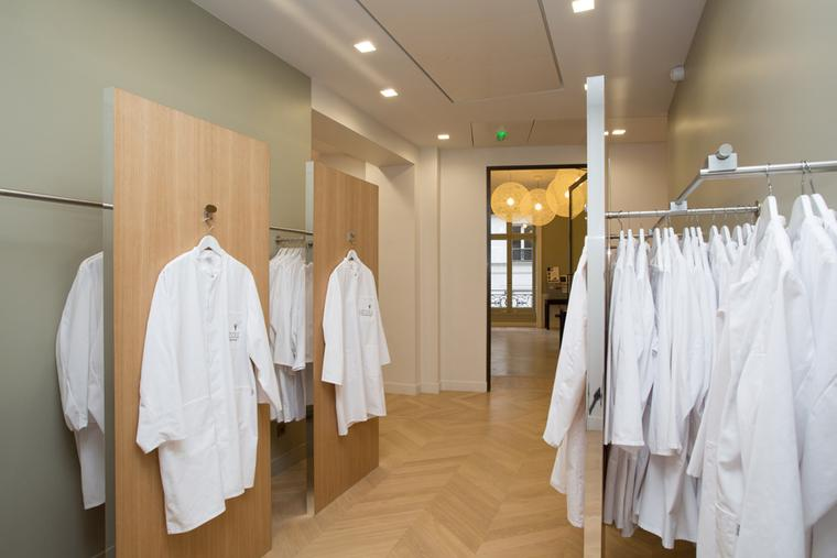 Lab coats for students partaking in L'École Van Cleef & Arpels workshop classes.