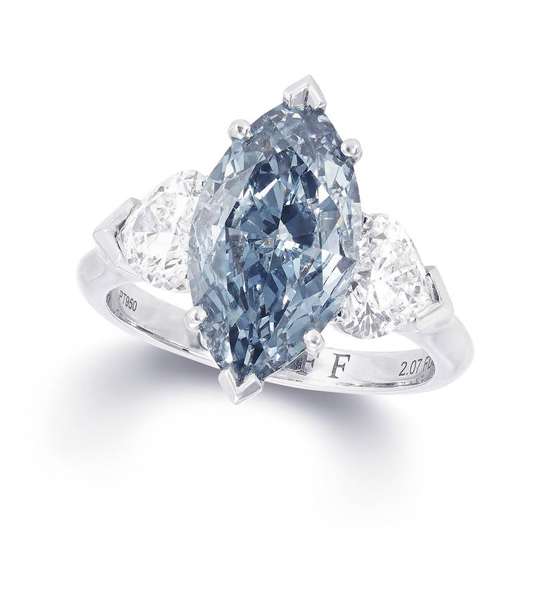 Graff marquise-cut blue centre diamond ring featuring two white diamonds.