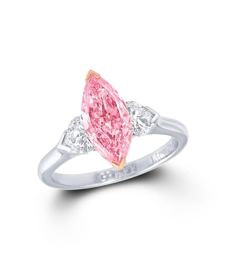 Graff marquise-cut pink centre diamond ring featuring two white diamonds.
