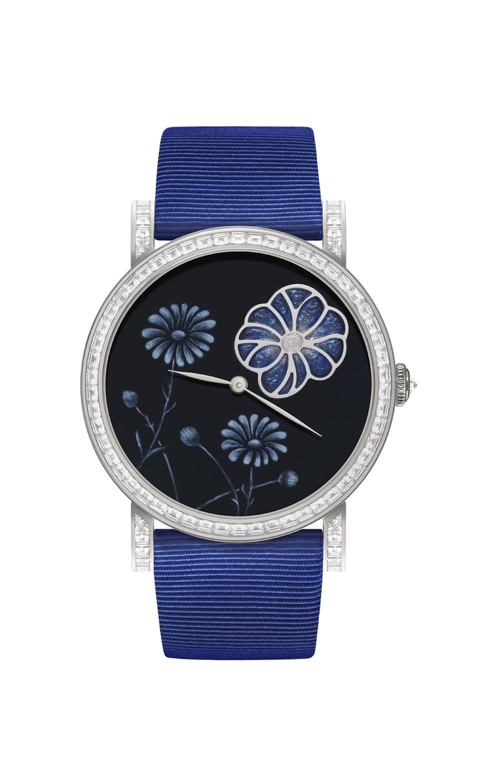 DeLaneau Daisy plique a jour watch features an intricate Grand Feu enamel dial and a white gold case set with 74 baguette-cut diamonds and 116 brilliant-cut diamonds, with a diamond-embedded crown.