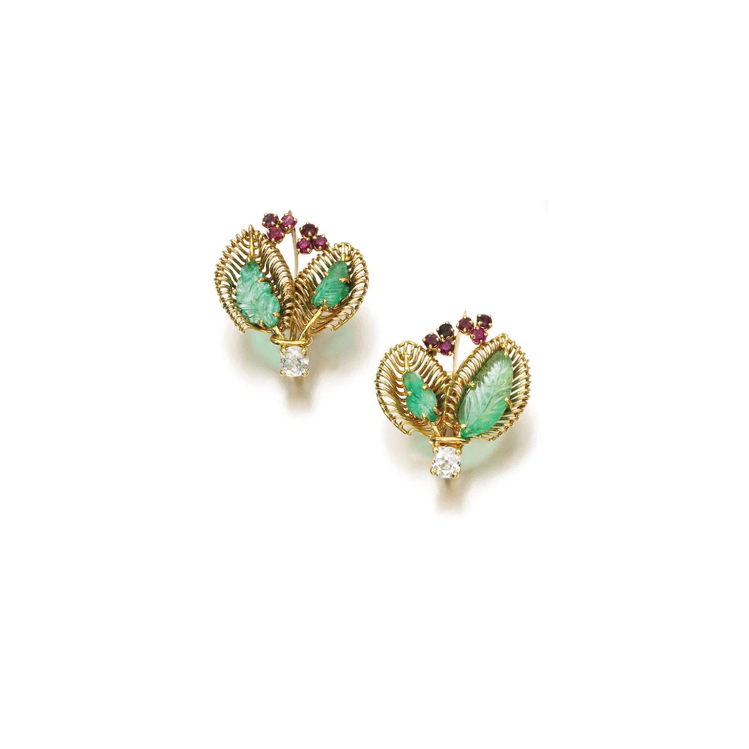 Lot 103, from the Daisy Fellowes collection, a pair of 1950s ruby, emerald and diamond earrings featuring a stylised bouquet design, each set with two foliate carved emeralds, circular-cut rubies and diamonds (estimate: £3,000-5,000; unsold)