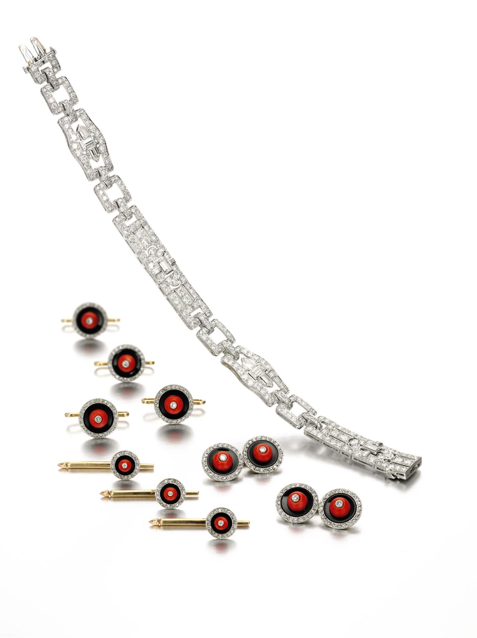 This Raymond Yard coral, onyx and diamond dress set sold for £13,750 and 1920s Cartier diamond bracelet sold for £31,250 at Sotheby's London in 2014.