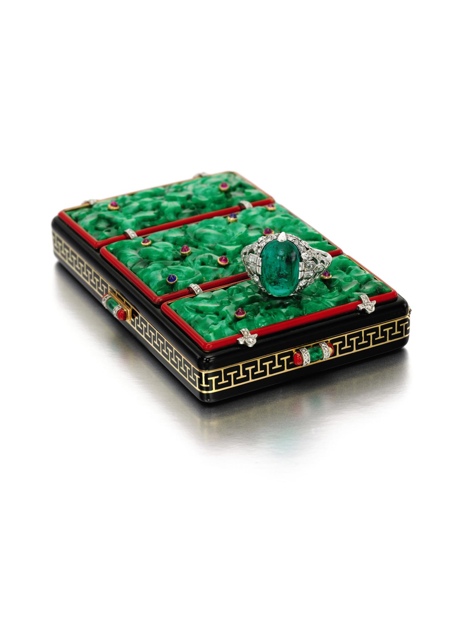Lot 282, Lacloche Frères 1920s gem set, enamel and diamond vanity case, set with three carved jadeite plaques inset with cabochon sapphires and rubies up for auction at Sotheby's London. (estimate: £ 8,000-12,000).