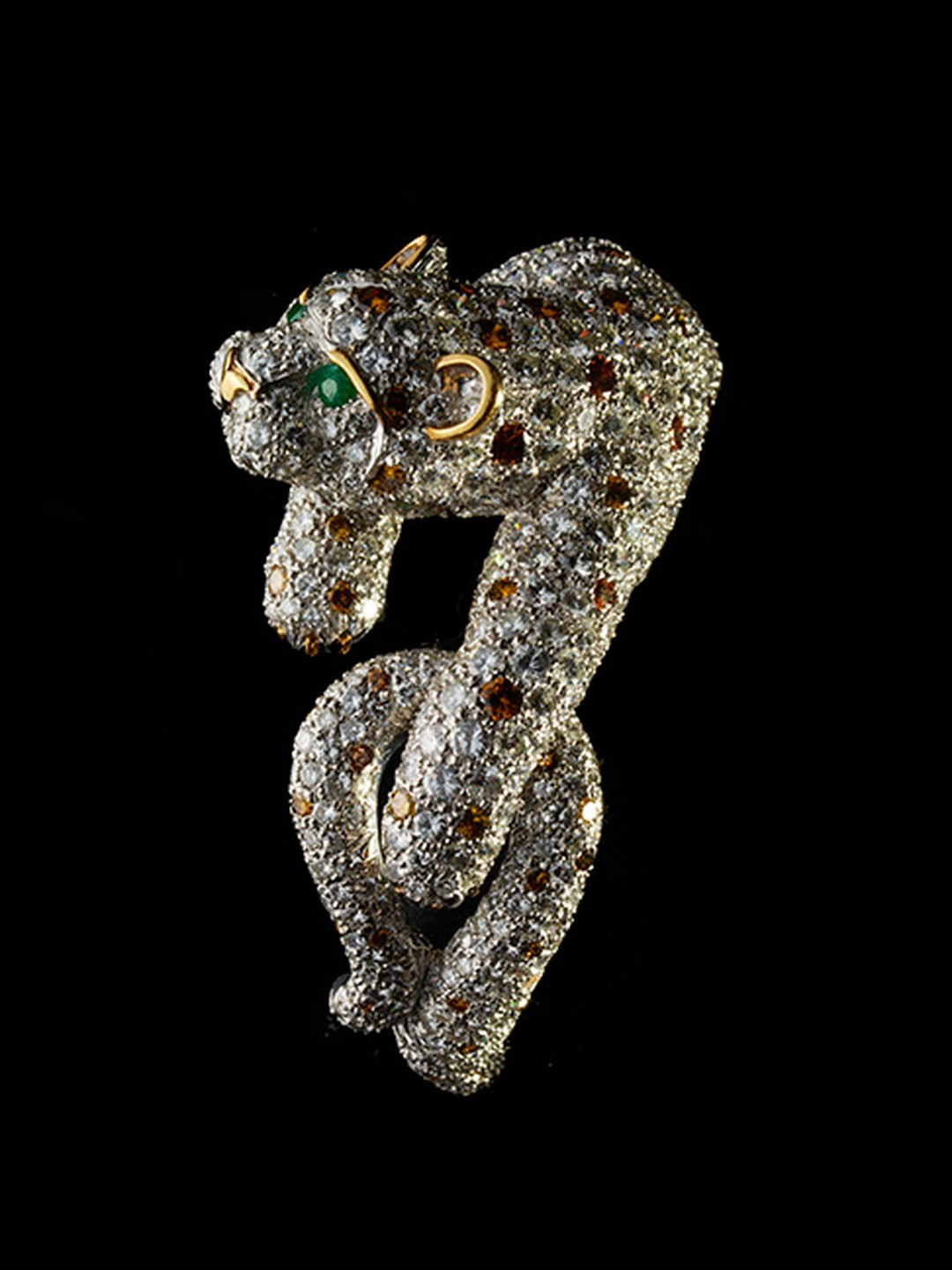 David Webb gold and platinum Panther bracelet featuring cabochon emeralds, rubies and diamonds.