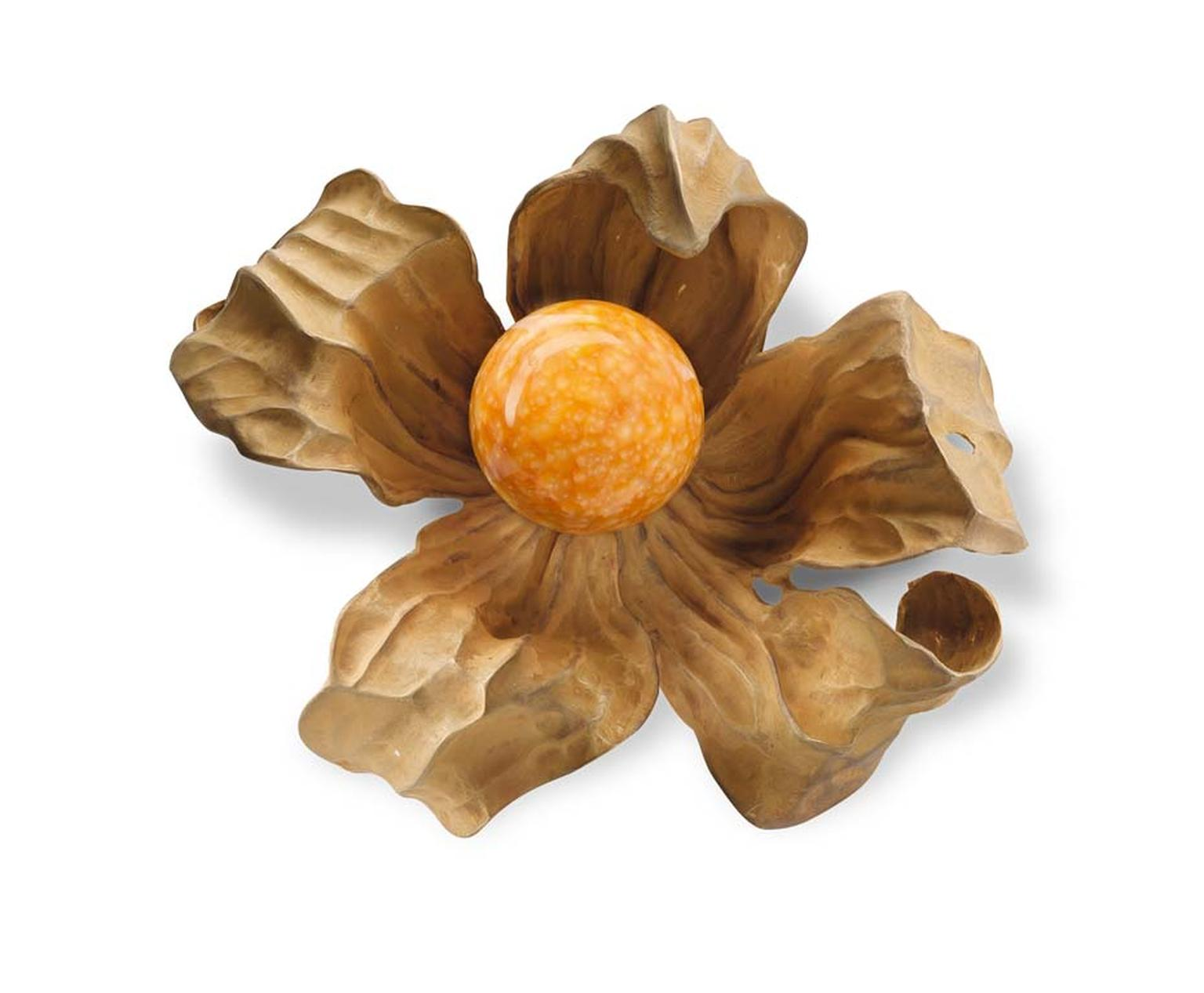Hemmerle physalis brooch featuring a rare sun-orange melo pearl shining inside a delicate lantern-like case rendered in gold