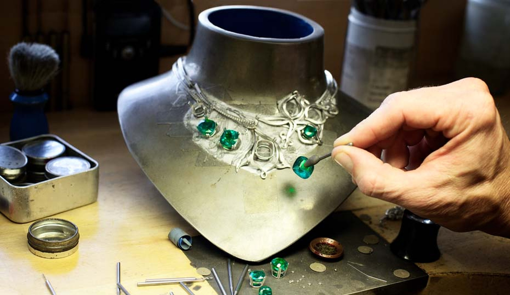 Seven cushion-cut emeralds totalling 46.2 carats being set into Boodles' Greenfire emerald necklace