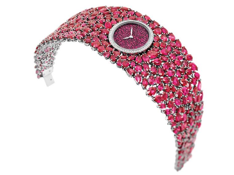 DeLaneau Grace Rubies jewellery watch in white gold, set with 284 rubies on the bracelet and 58 diamonds on the case. The oval dial is set with a further 210 rubies
