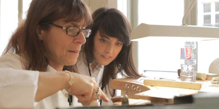 A student observes a jewellery professor in the L'École Van Cleef & Arpels Gemmology atelier