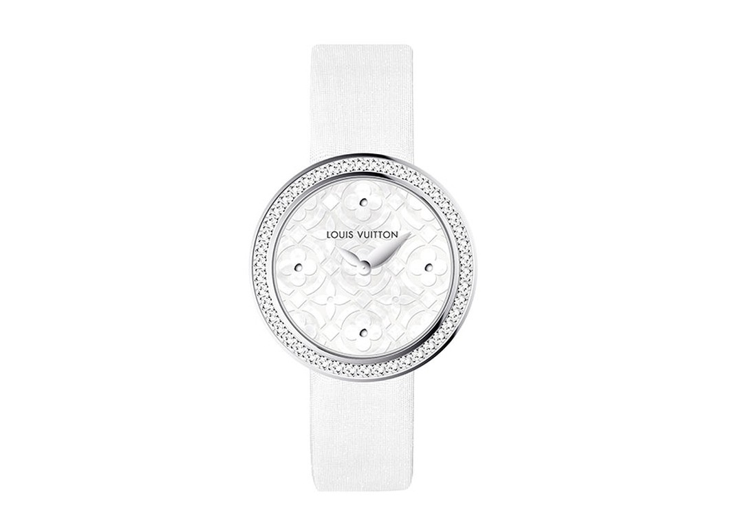 Louis Vuitton Dentelle de Monogram watch with a pearly white mother-of-pearl dial, diamond-set bezel and white satin strap