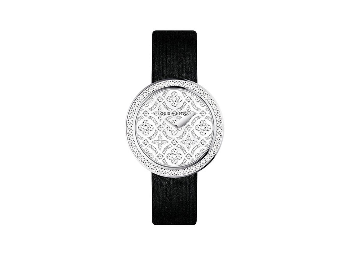Dentelle de Monogram watch with a pearly white mother-of-pearl dial set with diamonds featuring the iconic Louis Vuitton flowers and stars motif, surrounded by a diamond-set bezel, and black satin strap