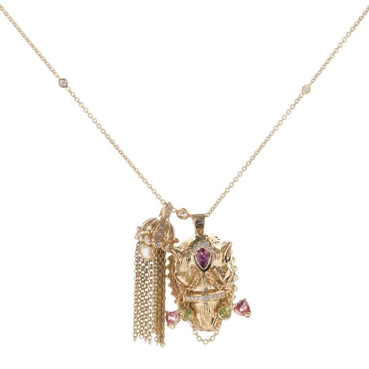 Sabine Roemer Parazide tassel Camel pendant in yellow gold, set with green peridots, pink tourmalines and a golden pearl
