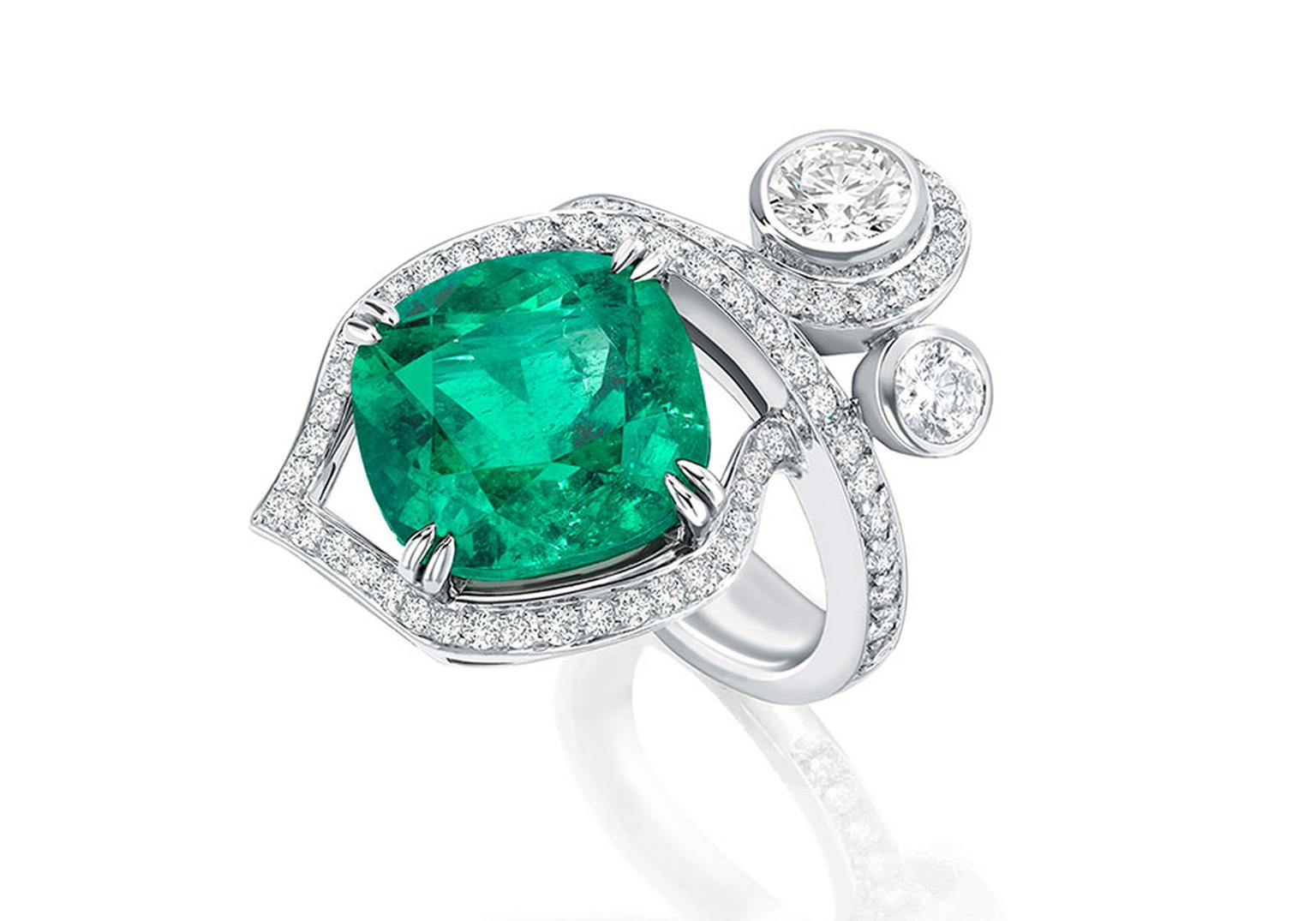 Boodles' Greenfire emerald ring, part of the Greenfire suite, features a single emerald surrounded by pavé diamonds and two brilliant-cut diamonds designed to appear as entwined forest foliage