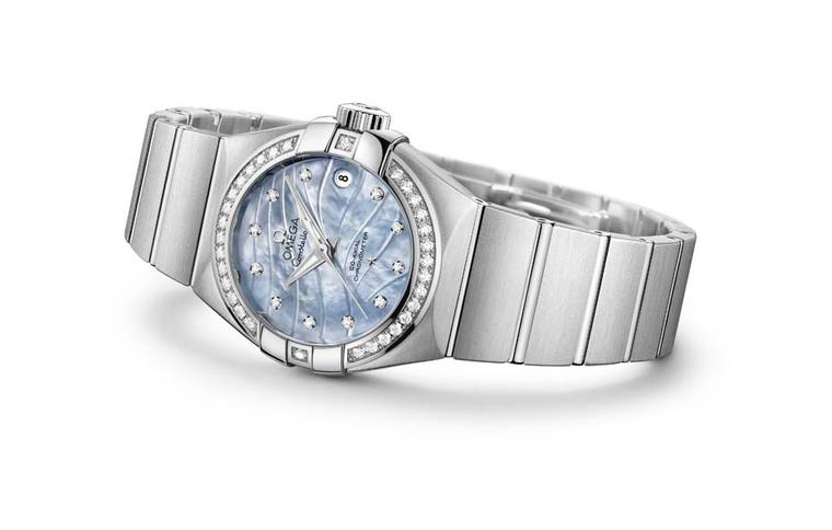 The stainless steel Omega Constellation Pluma features a blue mother-of-pearl engraved dial set with diamonds.
