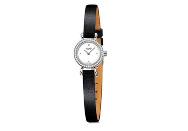 Hermès Faubourg watch featuring a diamond bezel.