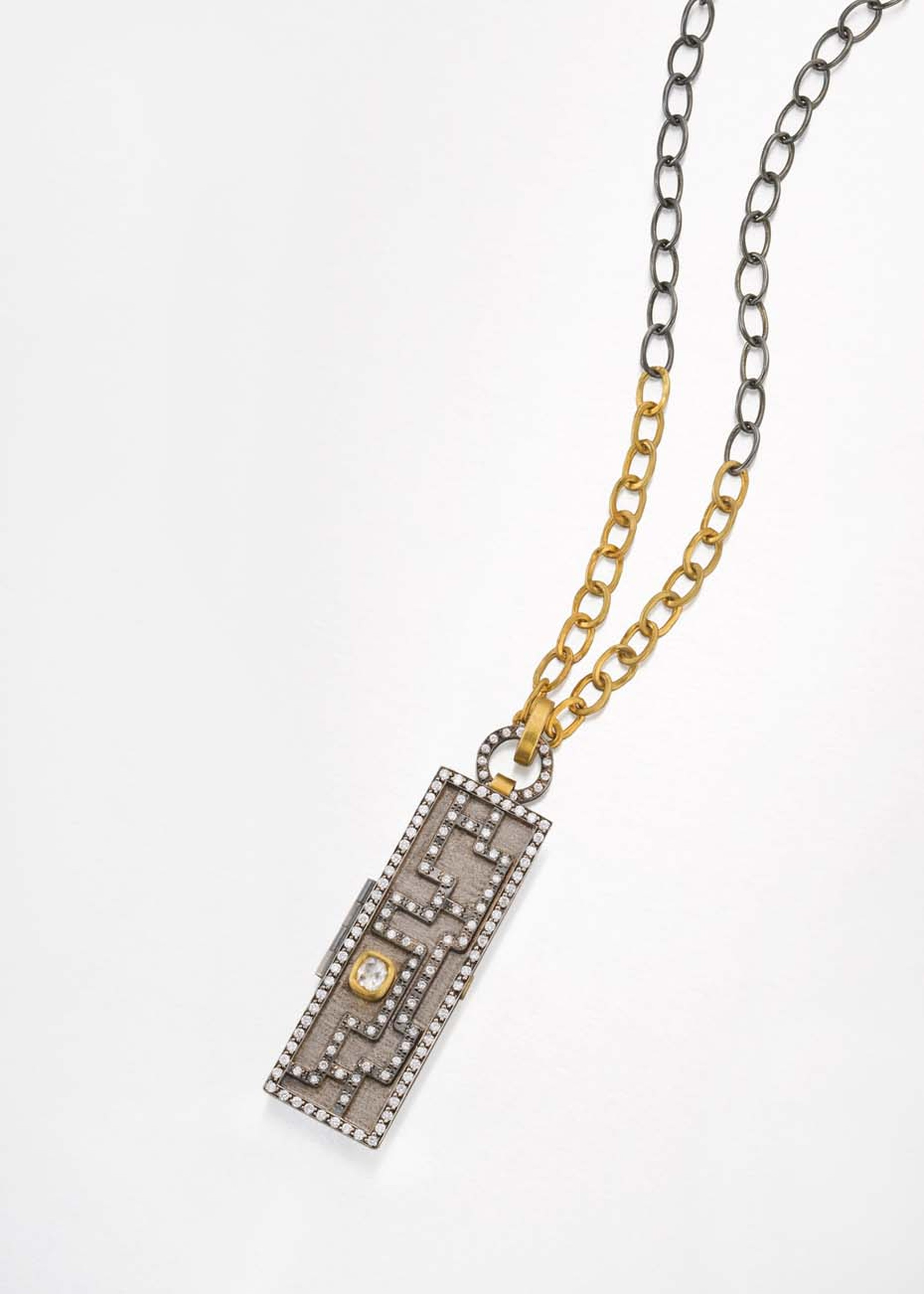 Annie Fensterstock blackened silver, white and yellow gold Maze locket with diamonds.