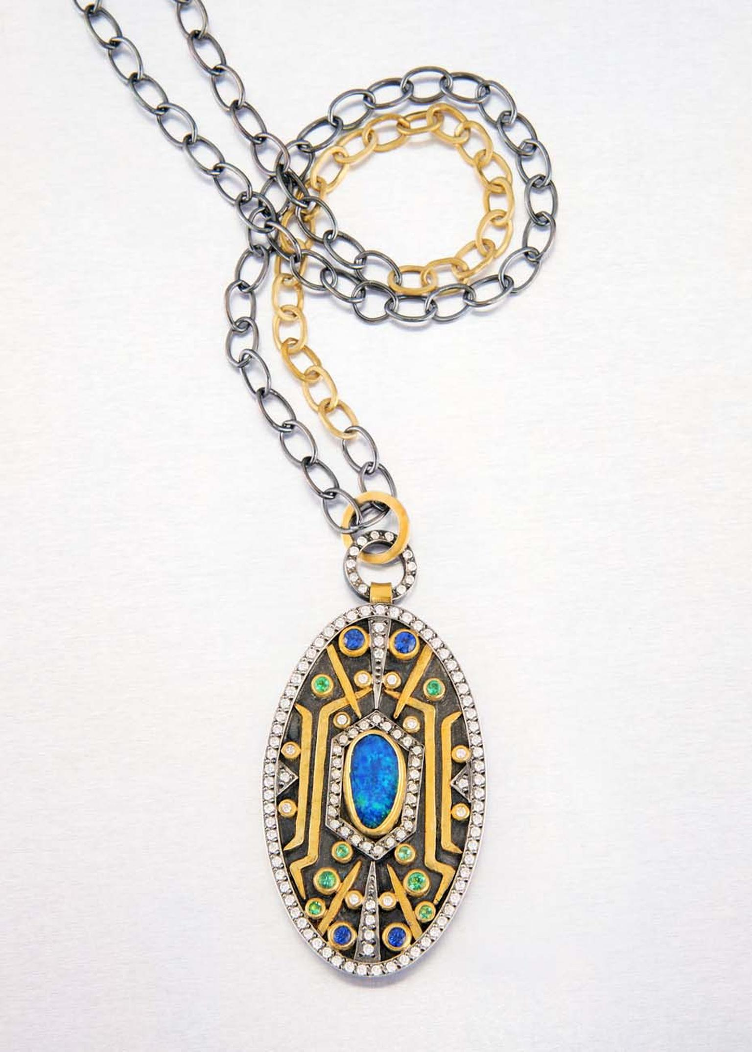 Annie Fensterstock gold and blackened silver Empire pendant featuring diamonds, sapphires, emeralds and opal.