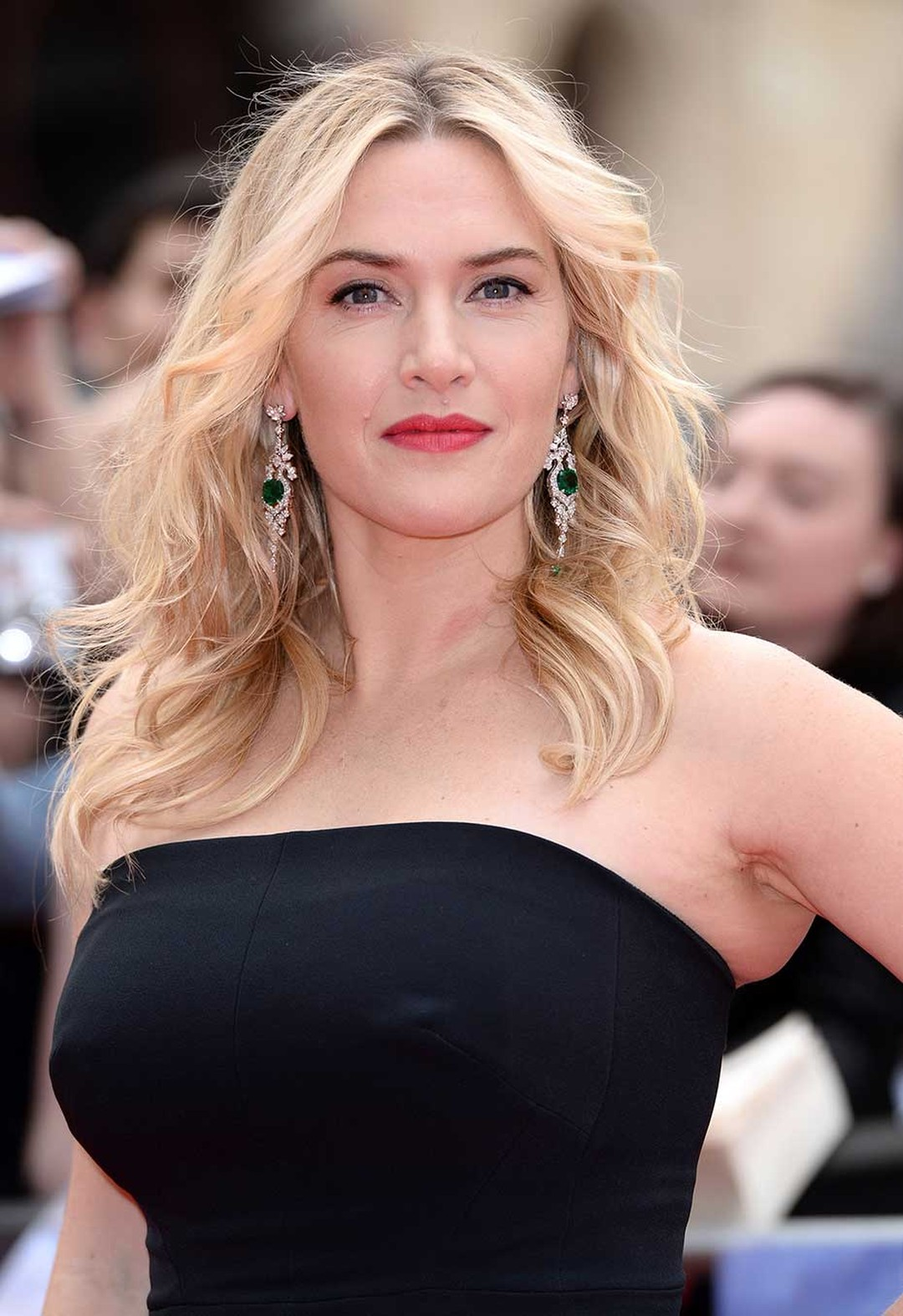 Kate Winslet looks radiant in David Morris emerald and diamond earrings as she says hello to fans at the London premiere of her film Divergent in March 2014.