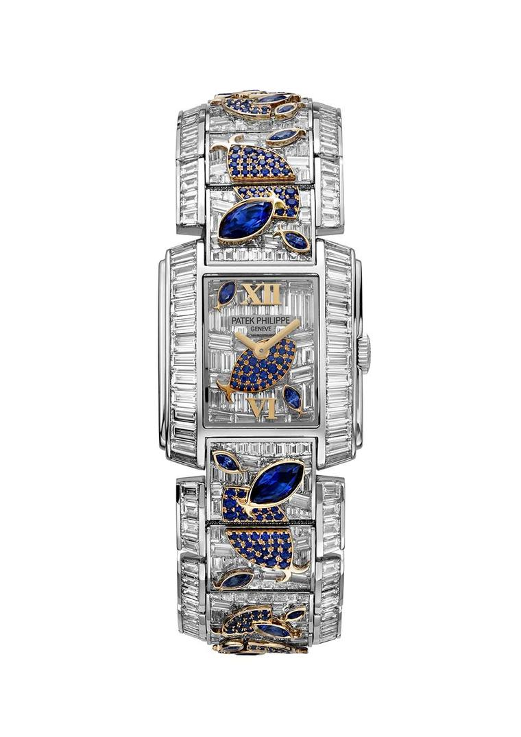 Inside the mini aquariums that form the bracelet and dial of Patek Philippe's Twenty-4® Haute Joaillerie Ref. 4909/110 'Aquatic Life' watch, the baguette diamonds have been invisibly set to create a watertight liquid environment for the blue sapphire fish