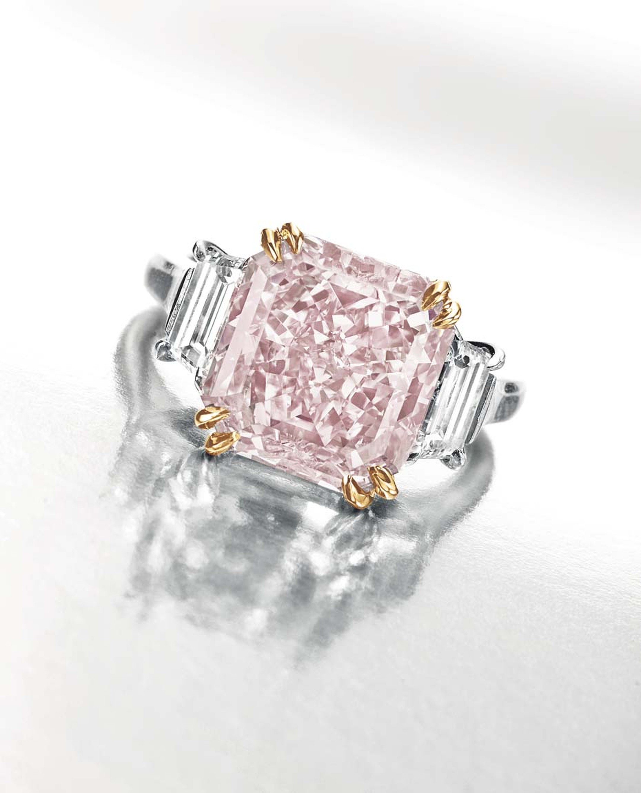 Lot 131, an important coloured diamond and diamond ring in platinum and rose gold by Harry Winston, set with a rectangular-cut fancy intense pink diamond weighing approximately 6.10ct, from the private collection of animal rights campaigner Riki Shaw (est