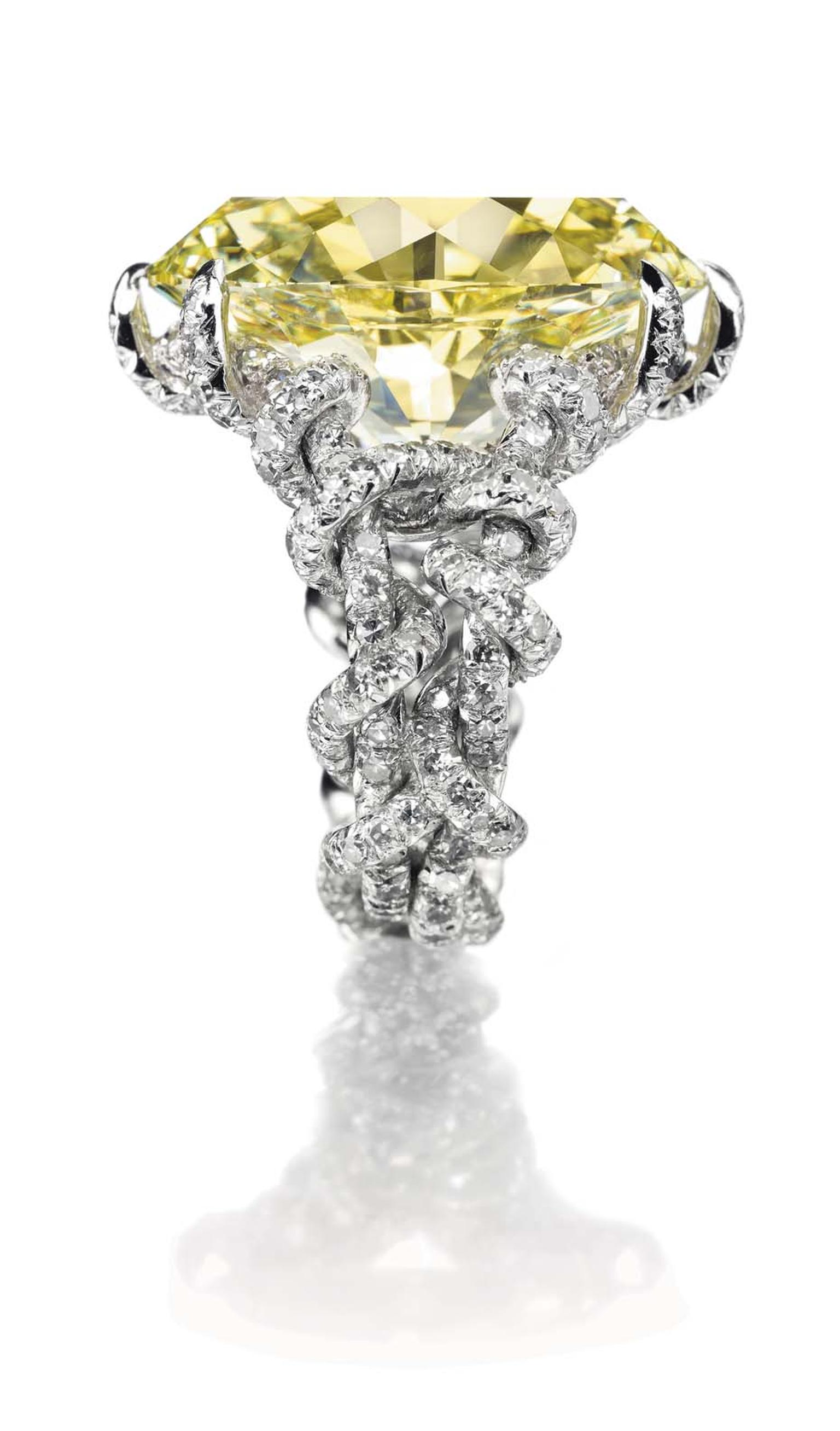 Lot 226, a coloured diamond and diamond ring by JAR, set with an oval-cut fancy intense yellow diamond weighing approximately 15.75ct, mounted in platinum (estimate: US$500-700,000)
