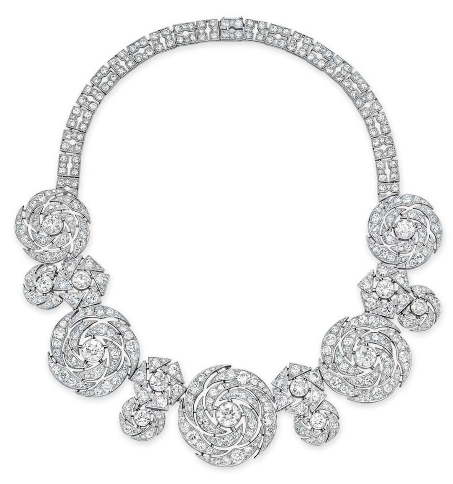Lot 230, a diamond necklace by Cartier, designed a a series of graduated openwork old European and single-cut diamond swirling plaques in platinum, circa 1942 (estimate: US$450-650,000)