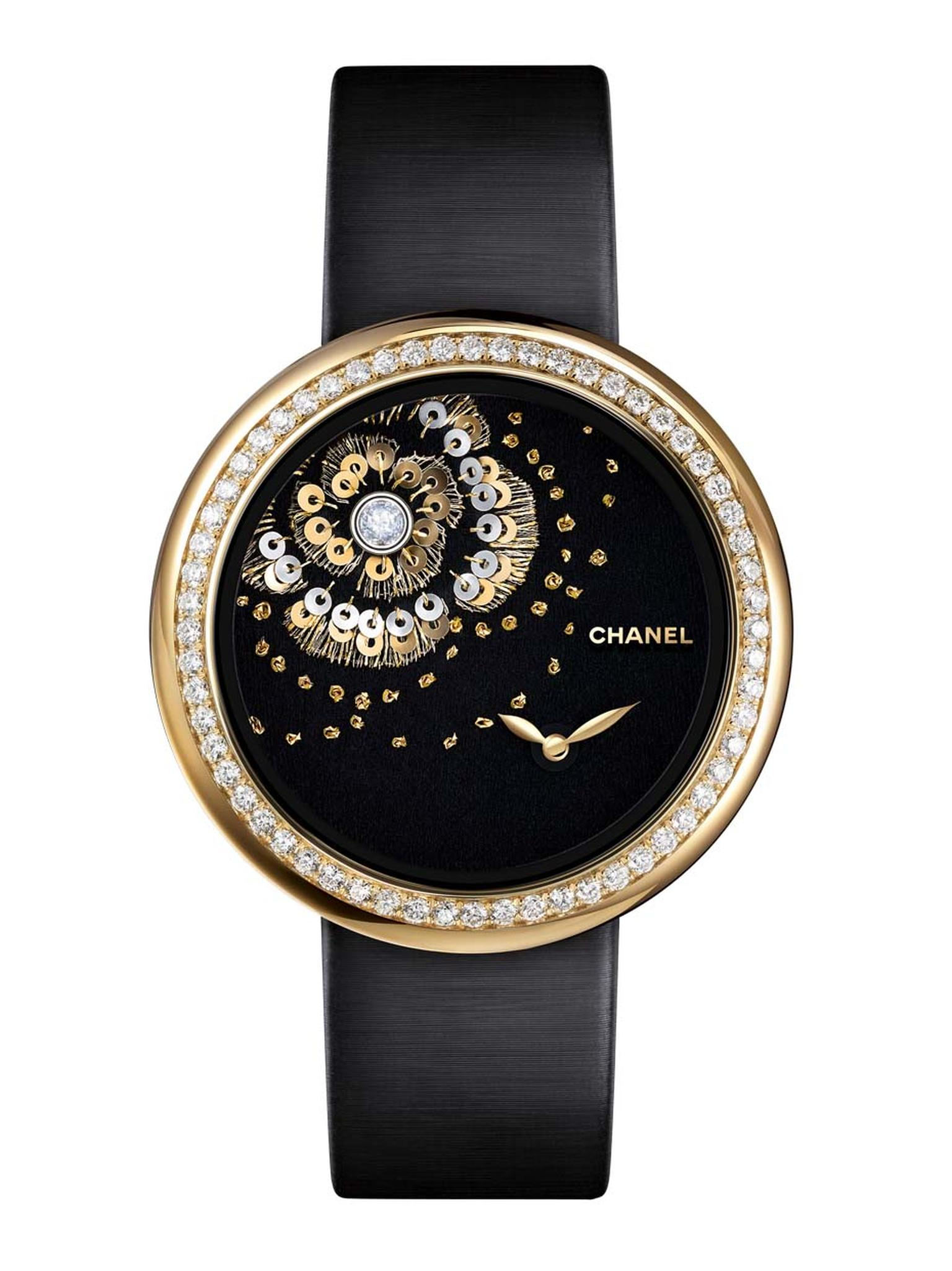 The new Chanel Mademoiselle Privé Camellia Brodé Lesage watch is hand embroidered with gold and green silk thread, white and yellow gold sequins and knotted camellia flowers, and set with a single rose-cut diamond on the dial