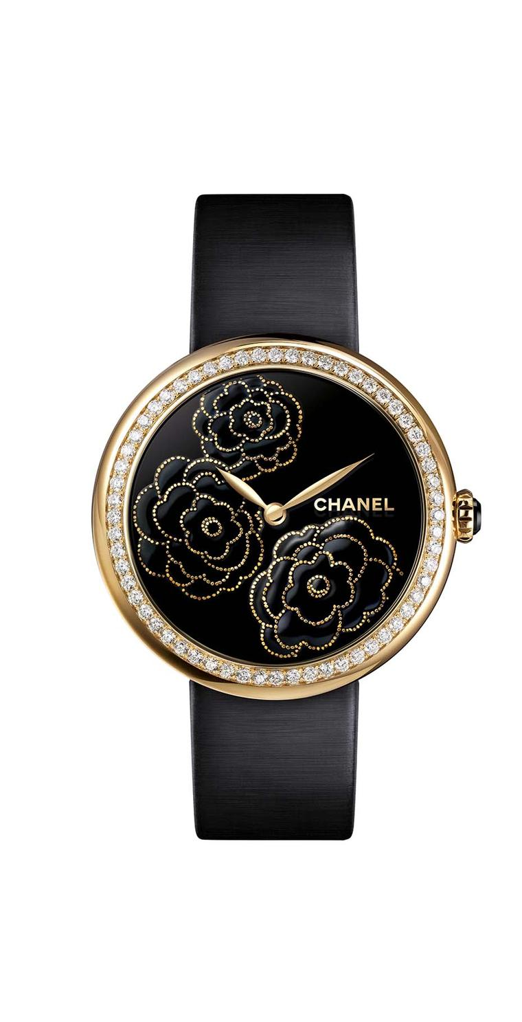 Chanel Mademoiselle Privé Camellia Maki-e watch in yellow gold and diamonds. The face is crafted using the ancient Japanese technique of Maki-e in black lacquer and yellow gold