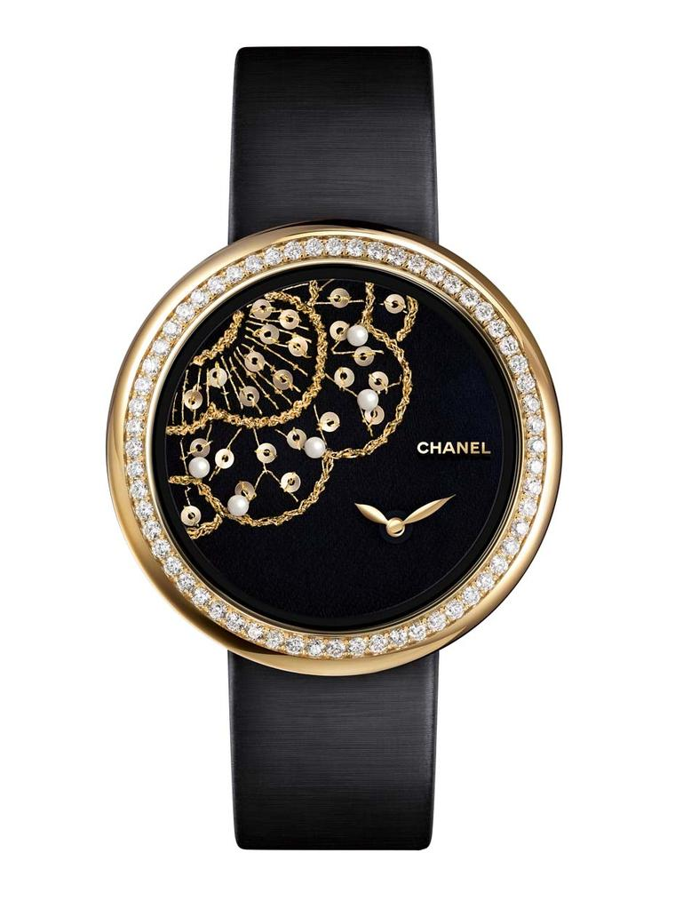 One of three new Chanel Mademoiselle Privé Camellia Brodé Lesage watches, hand embroidered with yellow gold and green silk thread, gold sequins and natural pearls