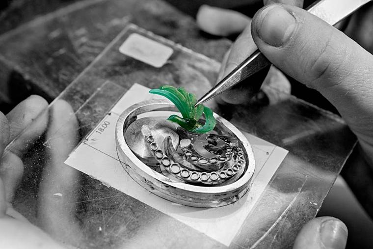 A three-dimensional prototype of the Paon de Lune - or moon peacock - is put in place to ensure the perfect fit before it is crafted in white gold