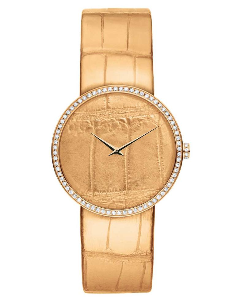 La D de Dior Alligator watch in pink gold and diamonds. The dial is coated in pink gold and embossed with an alligator pattern, while the alligator strap is coated with pink gold leaf