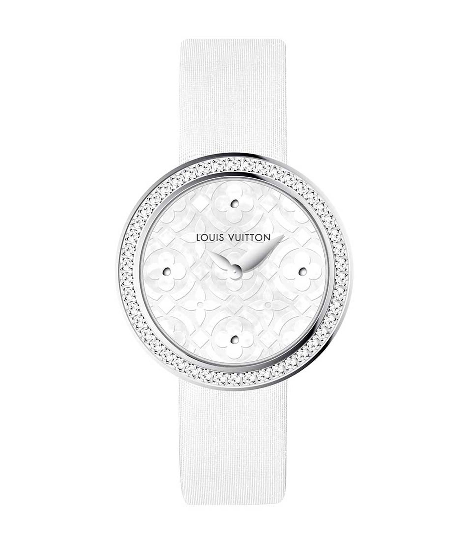 New for 2014 is the Louis Vuitton Dentelle de Monogram watch with a pearly white mother-of-pearl dial, diamond-set bezel and white satin strap