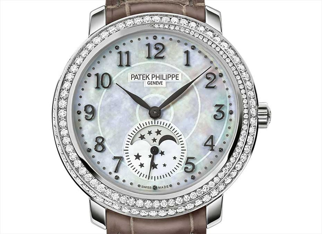 The sparkling ribbon of diamonds and ever-changing hues of the mother-of-pearl dial on the new Patek Philippe Ref. 4968G-010 Moon phase watch for women capture the beauty of the cosmos