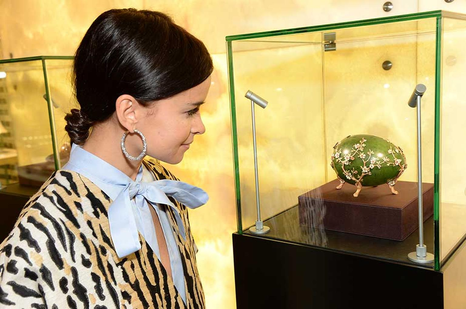 Miroslava Duma with the Fabergé 1901 Apple Blossom egg during the 'A Fabergé Easter at Harrods' event which runs until the 21st of Aoril.