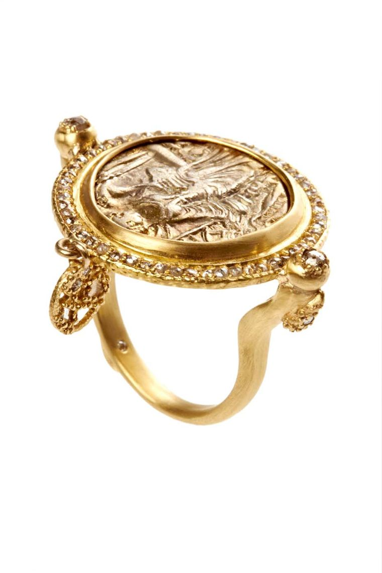 Coomi Antiquity coin ring in gold with diamonds.