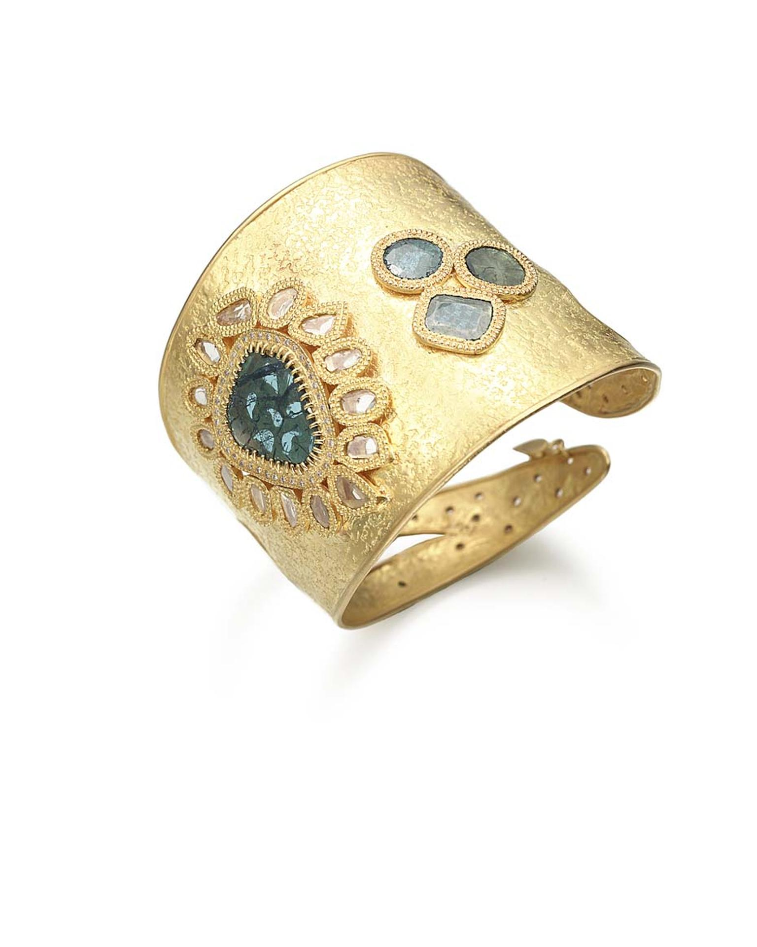 Coomi gold cuff with blue diamonds.