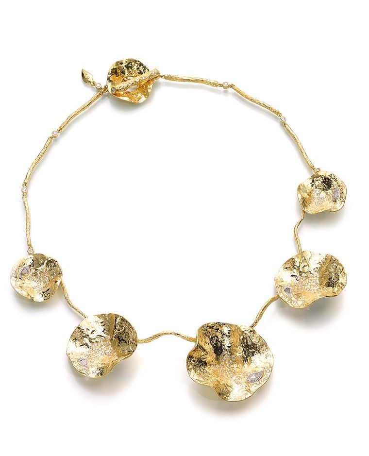 Coomi Serenity Flower bracelet with gold and rose-cut diamonds.