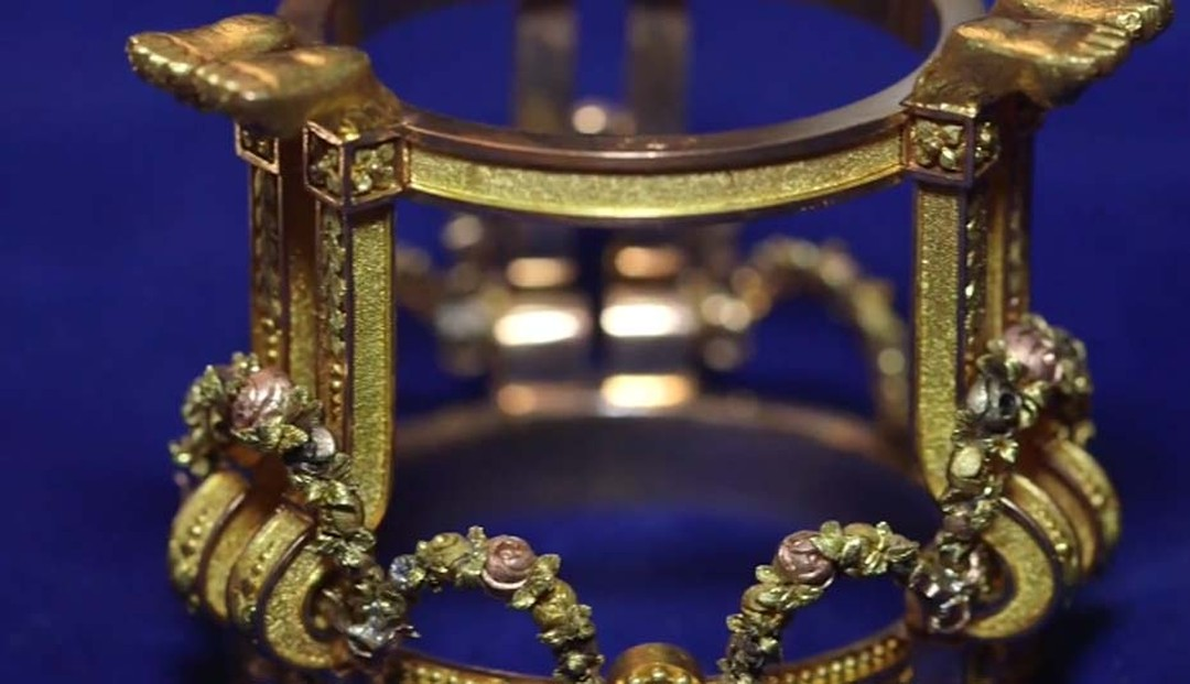Holding the Imperial Fabergé Easter Egg in place is a gold stand adorned with garlands and roses- expressions of love.