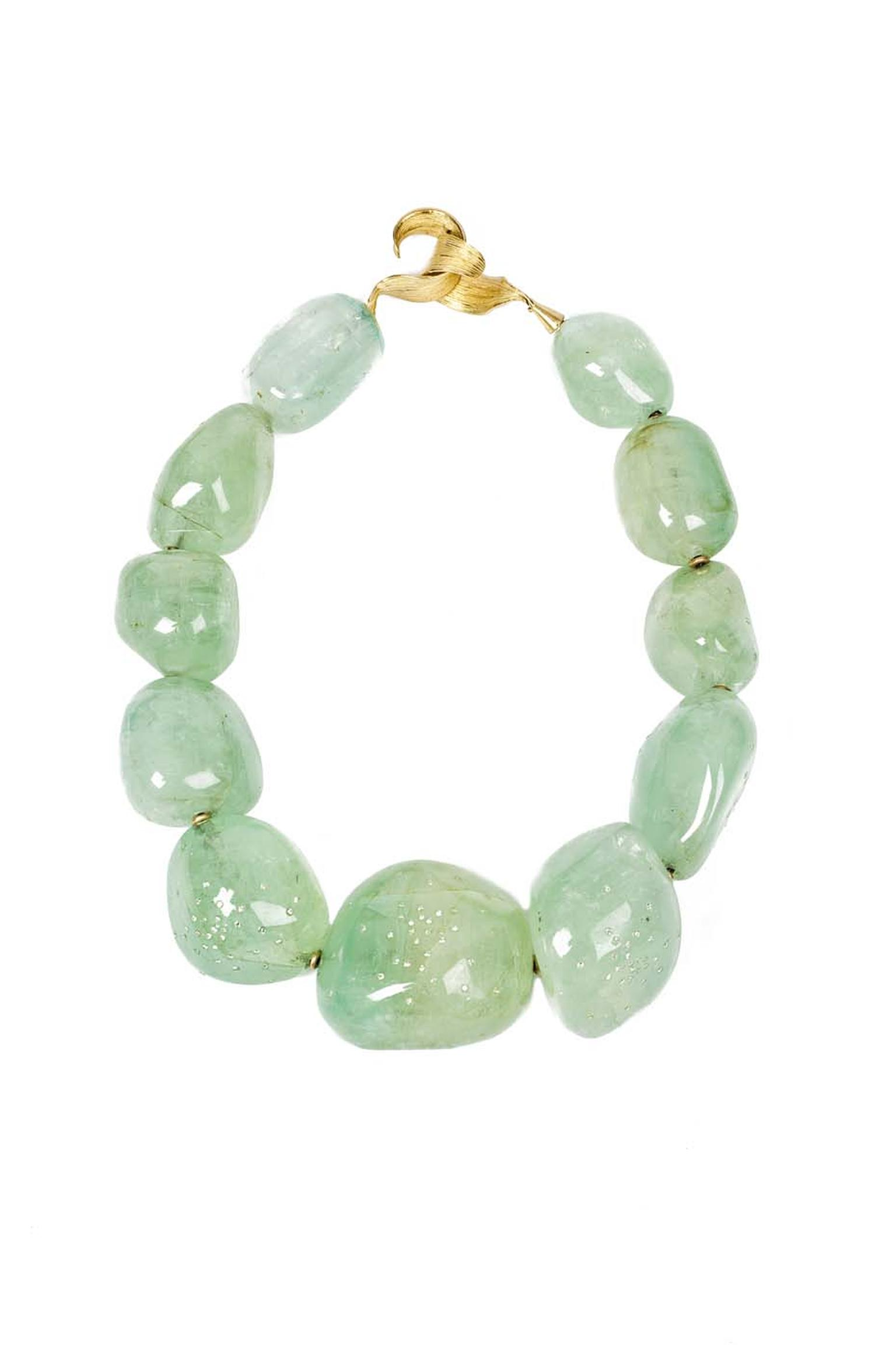 Gurmit Campbell Among Heavenly Bodies gold necklace featuring diamond encrusted pale emerald.