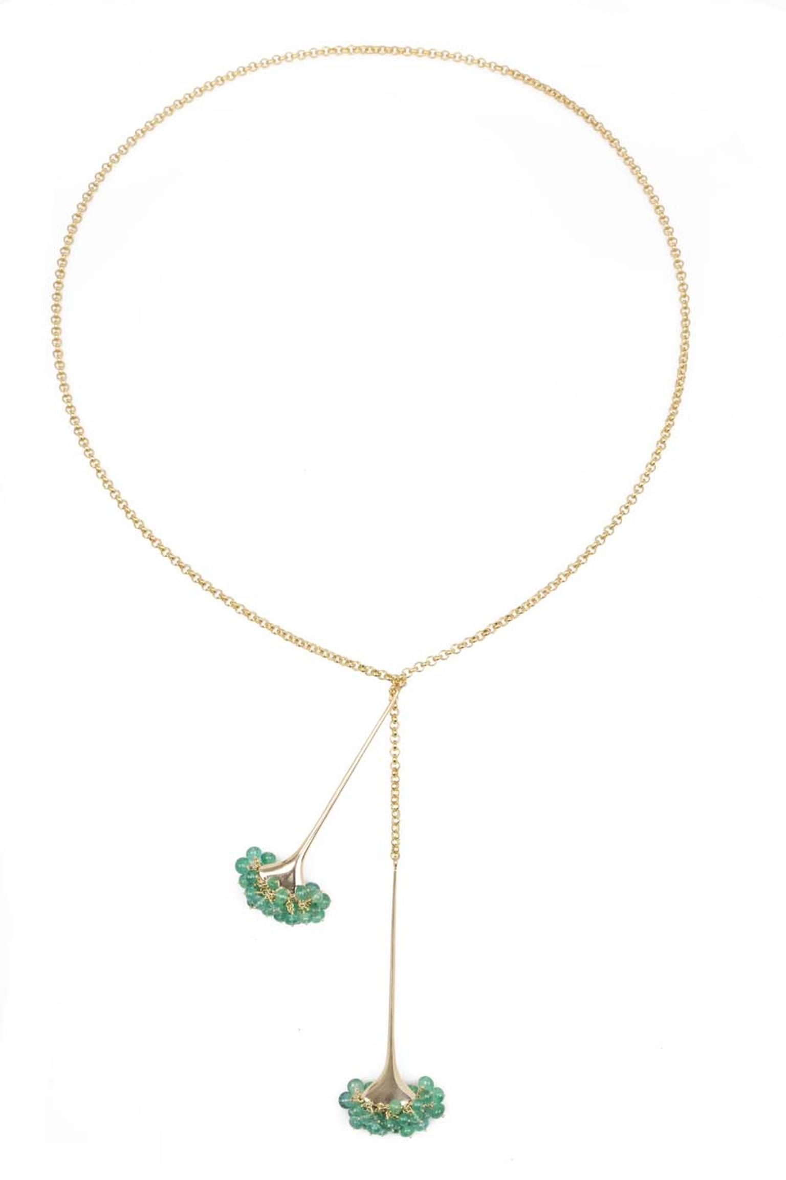 Gurmit Campbell gold Toga necklace featuring emerald beads.