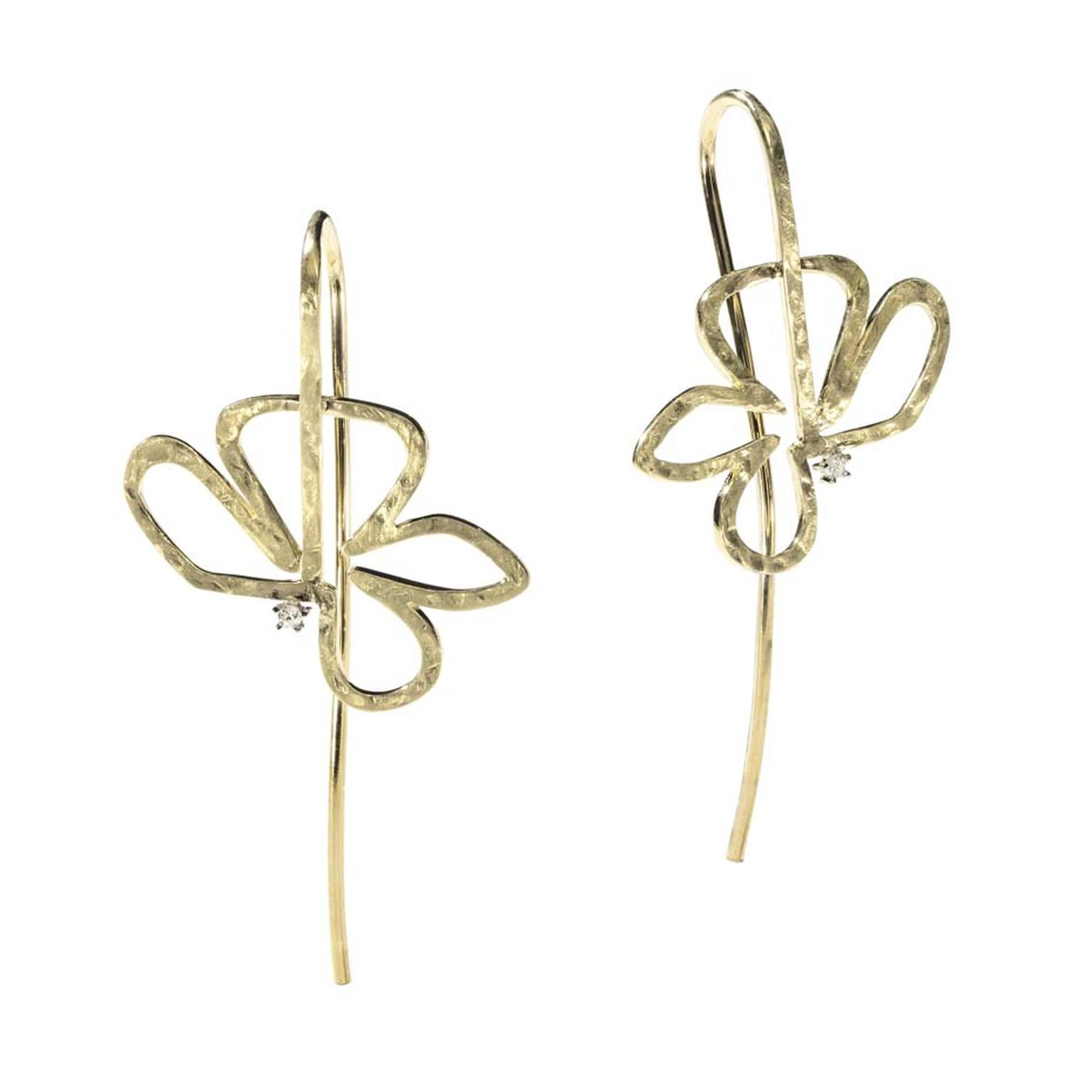 H.Stern's 2014 Oscar Niemeyer collection gold earrings featuring one diamond each displays a hollow flower design, representing Niemeyer's love of empty spaces.