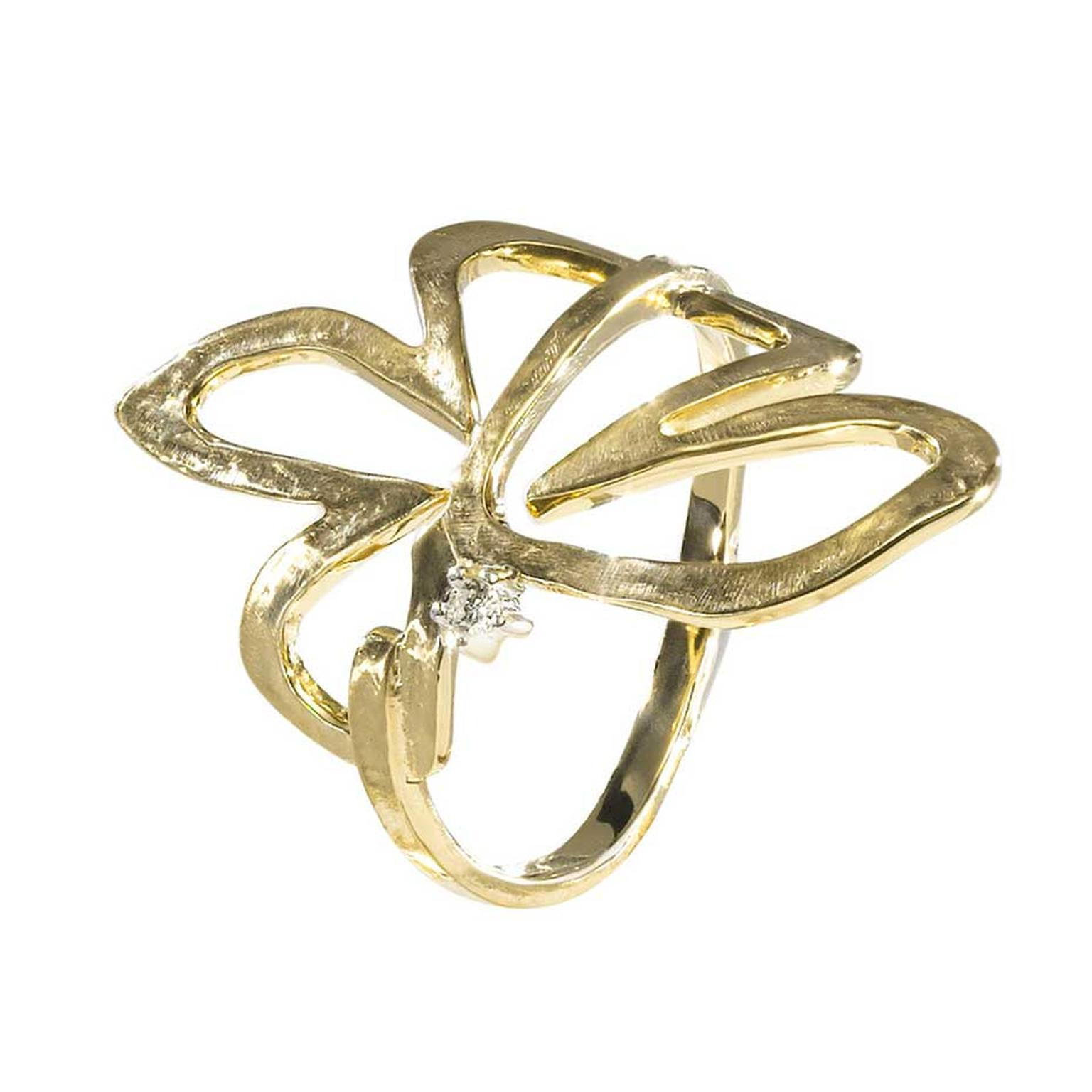 H.Stern's 2014 Oscar Niemeyer collection yellow gold flower ring featuring a single diamond.