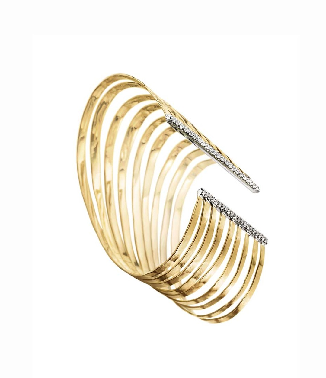 Inspired by the Copan building is H.Stern's 2008 collection of Oscar Niemeyer jewellery featuring a yellow and white gold wave bracelet with diamonds at the edges.