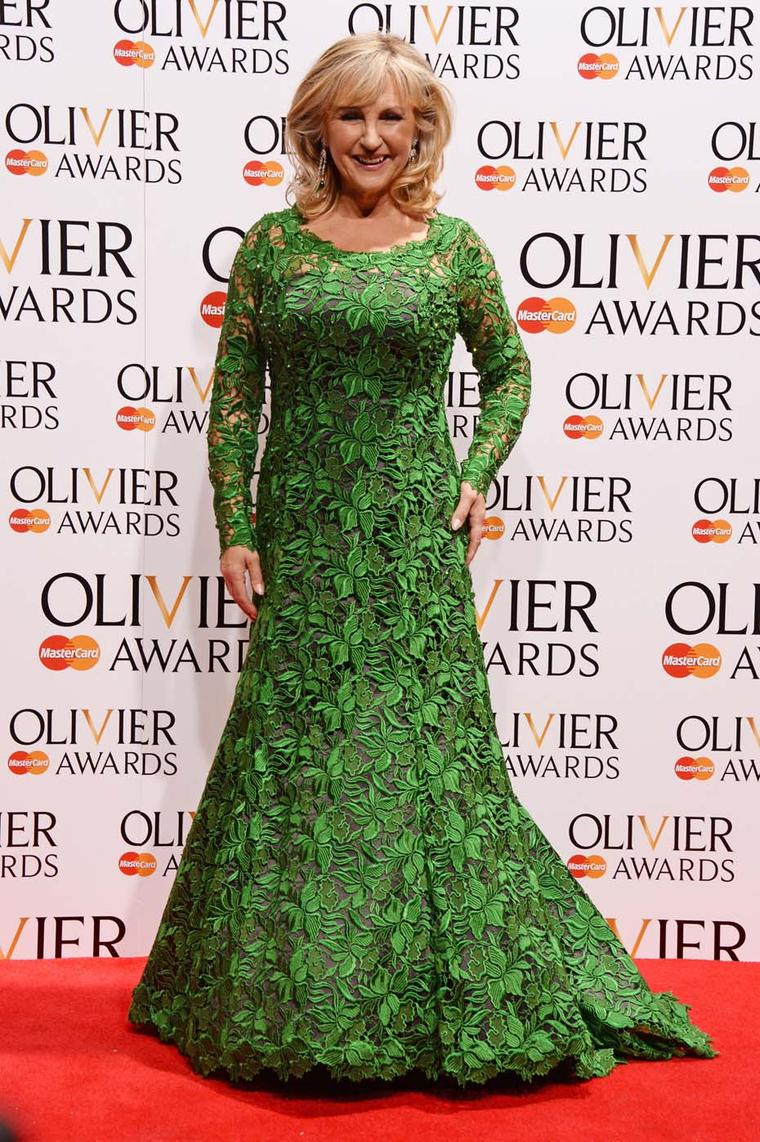 Worn by Opera singer and presenter Lesley Garrett, David Morris' Art Deco style diamond and emerald drop earrings feature natural cabochon emeralds (52.67ct) and diamonds (18.36ct).