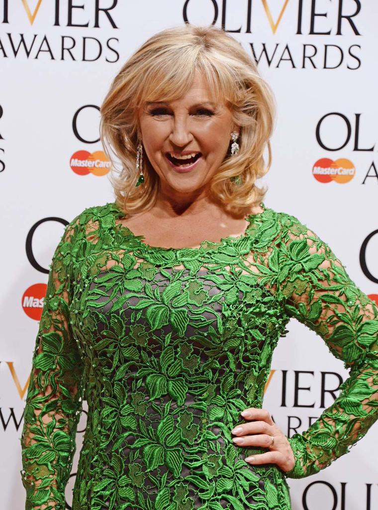 Opera singer and presenter Lesley Garrett wore David Morris' Art Deco style diamond and emerald drop earrings.