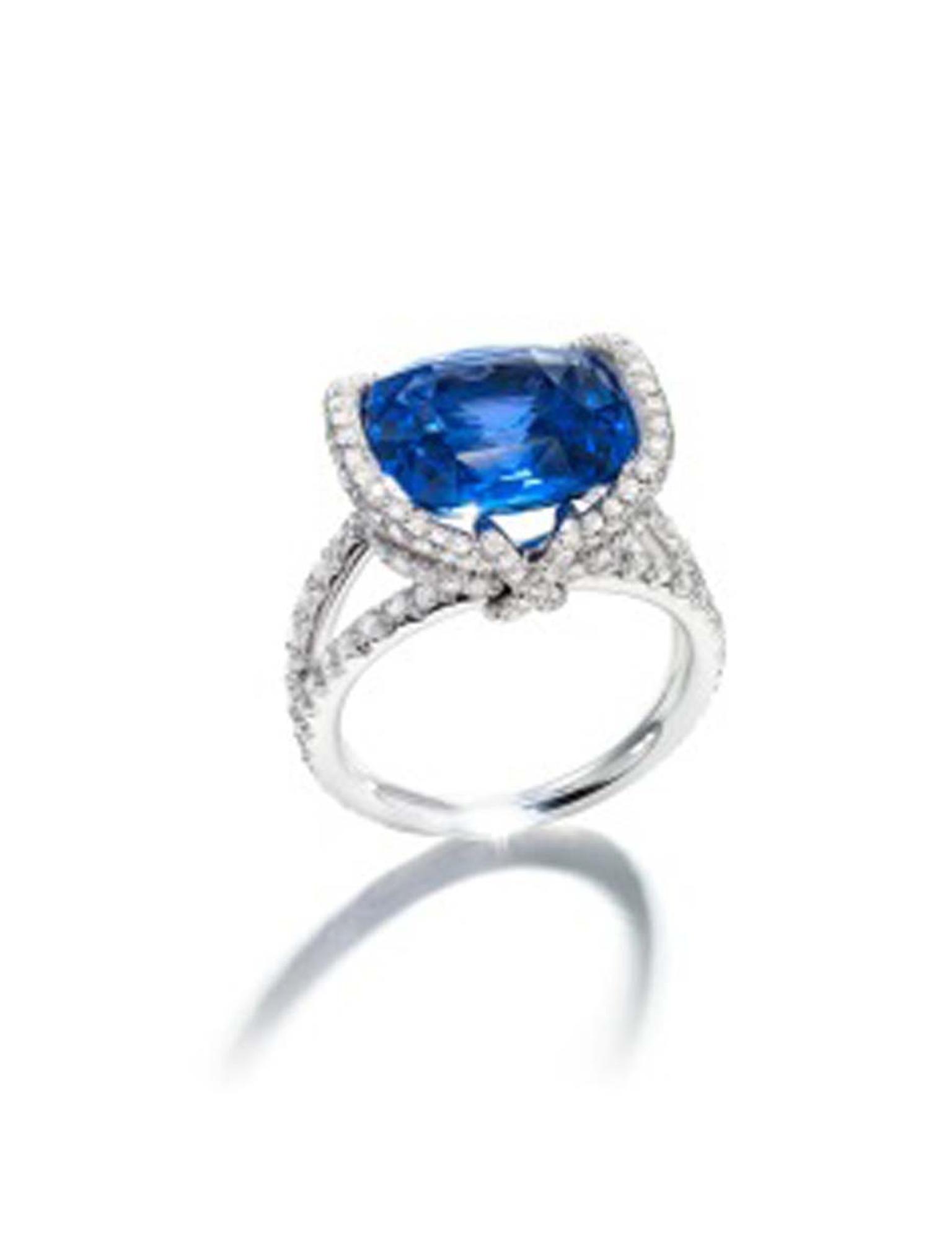Chaumet Liens ring with a centre sapphire surrounded by diamonds.
