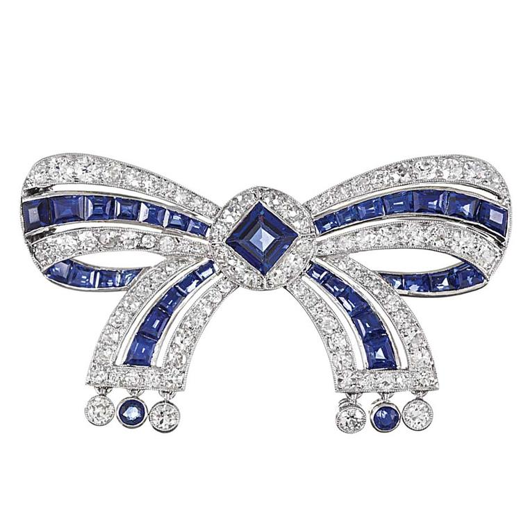 Cartier Important Early Art Deco Sapphire Diamond Bow Pin ($45,000), available at 1stdibs.com. Image by: ScullyFoto.com