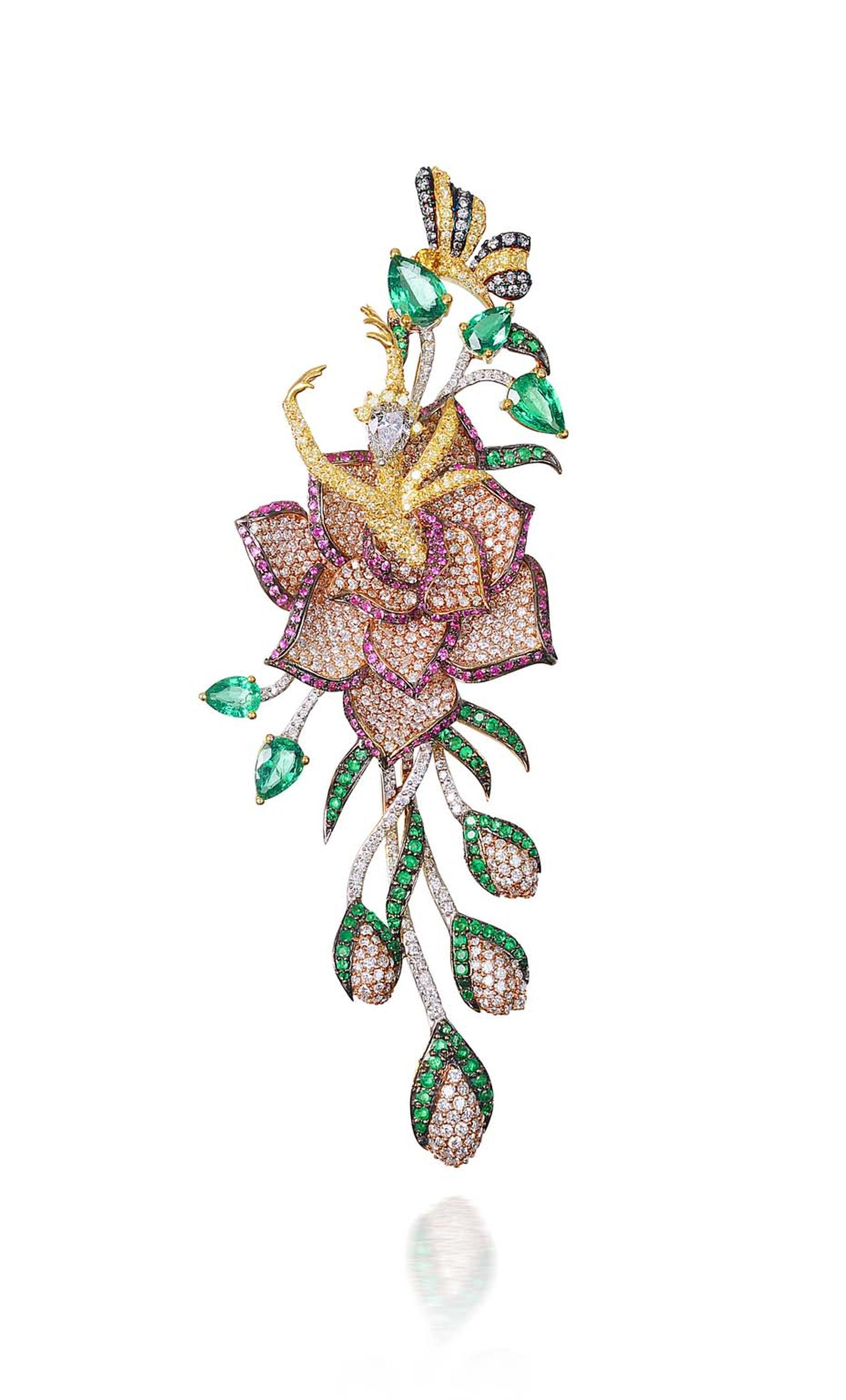 Lot 4, a brooch and hairpiece by Hazoorilal Jewellers, studded with white and yellow diamonds alongside Gemfields emerald and rubies (estimate: INR 2,100,000 - 2,500,000; $35,000 - 42,000)