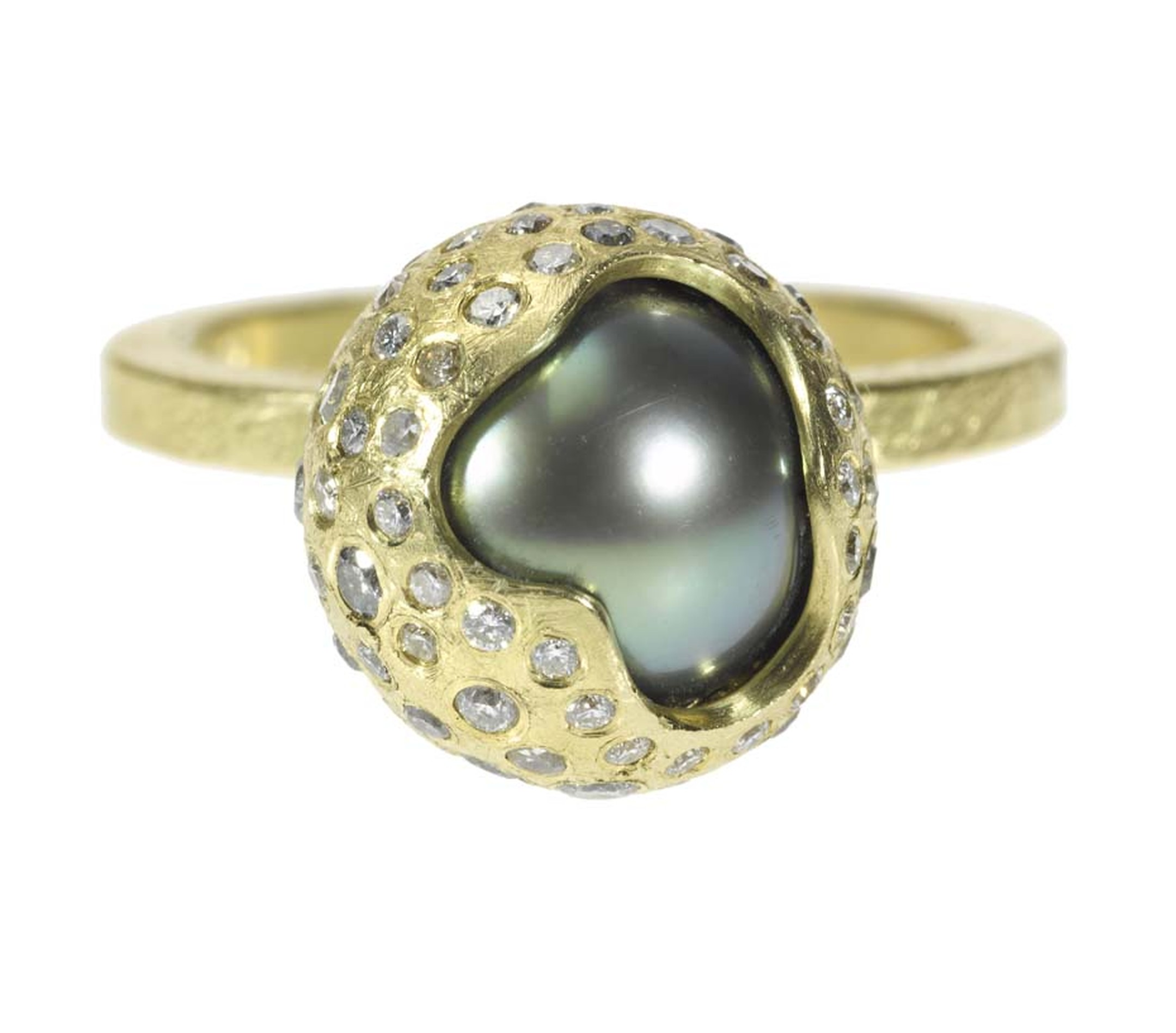 Todd Reed's new pearl collection featuring Tahitian pearl orbs which peek out of diamond-encrusted, textured metal casings.